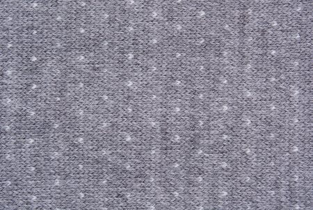Texture of knitted woolen fabric for wallpaper and an abstract background. Winter pattern. Stock Photo