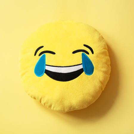 Emoji as soft yellow pillow. Close up. Pattern Stock Photo