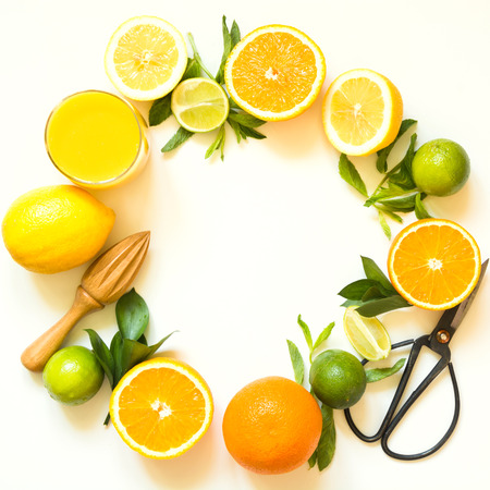 Set of citruses on white background, flat lay. Top view on oranges, lemons, lime and mint. Making detox freshes concept and recipe mockup. Copy space. Tropical background.