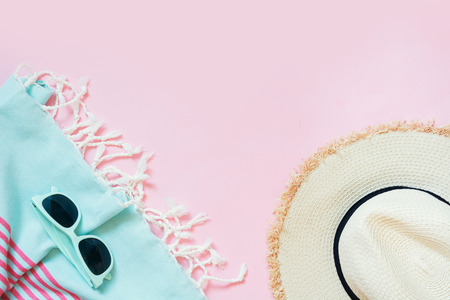 952a5f9a Straw beach sunhat and sun glasses on punchy pink with space for text. Female  outfit