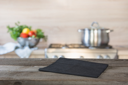 Blurred background. Modern kitchen with empty wooden tabletop and space for you. Archivio Fotografico