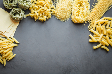 Different types of pasta from durum wheat varieties for cooking Mediterranean dishes. Top view, space for text.