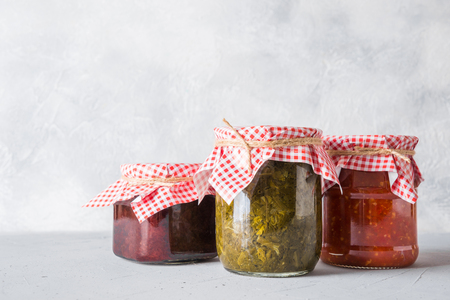 Various types of canned homemade sauce for serving to meat, adjika from tomato, sorrel, tkemali from plum. Homemade preparations, Homework and traditions. Banco de Imagens