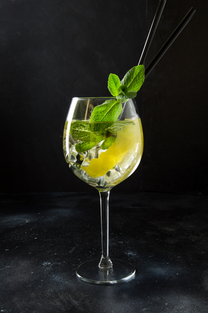 Mojito cocktail or lemonade with mint in glass on black. Close up. Summer drink. Imagens - 122730921