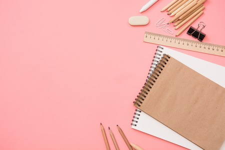 Colorful school supplies on pastel pink background. Top view, flat lay. Space for text.