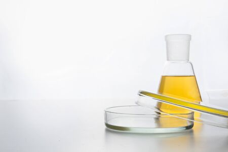 Chemistry glassware with blue liquid for science research and experiment. Space for text. Stock Photo