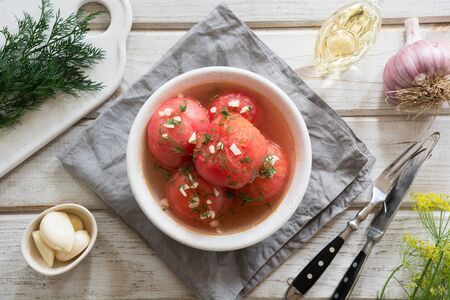 Marinated peeled tomatoes with garlic and dill, fresh ready to serve. Top view. Stok Fotoğraf