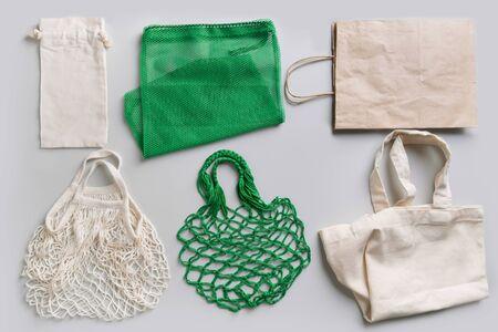 Set of eco friendly reusable shopping bag on grey. Zero waste concept.