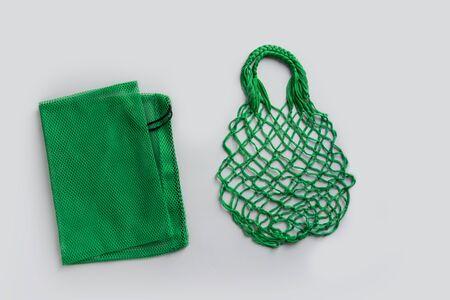 Empty shopping mesh bag on grey. Zero waste concept.