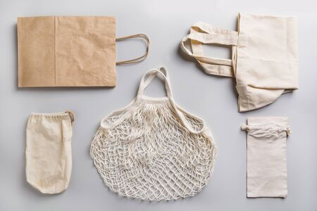 Paper, cotton and mesh bags for zero waste shopping on grey. Zero waste concept.