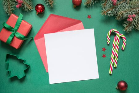 Christmas empty blank letter to Santa or invitation on green. Top view with copy space.
