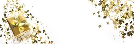 Christmas banner with luxury golden decoration on shine white background. Flat lay. View from above. Xmas pattern.