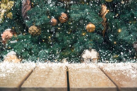 Wooden empty tabletop and blurred Christmas tree for display your product. Holiday Xmas background Stock Photo