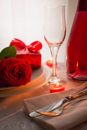 Festive or romantic dinner with red rose and champagne. Romantic invitation. Valentine day. Reklamní fotografie