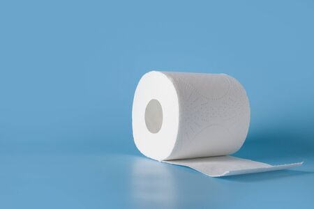 Roll of soft toilet paper on blue table with space for text. Increased potential. High unexpected demand. Deficit. Sold out.