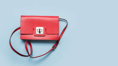 Red womens clutch for special date on blue. Flat lay. View from above, Close up. Copy space. Stok Fotoğraf