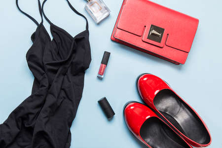 Elegant little black dress and classic red accessories for special date. Flat lay. View from above. Party preparations Stok Fotoğraf