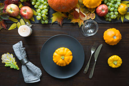 Fall table place setting decorated vegetables, grape, pumpkins, aplles, harvest. Thanksgiving Day
