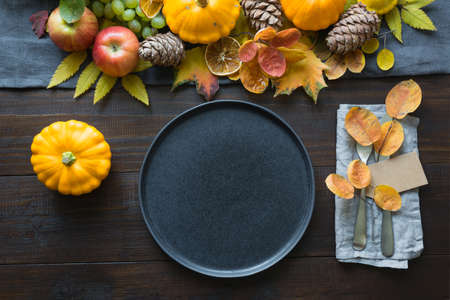 Fall table place setting decorated pumpkins, autumn harvest. View from above.