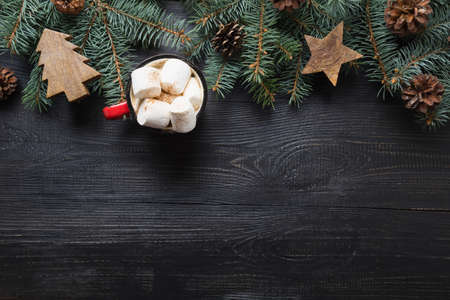Christmas gift, coffee, marshmallow, wooden diy, evegreen fir tree on wooden board. Top view. Space for text. Xmas vibes. Stok Fotoğraf