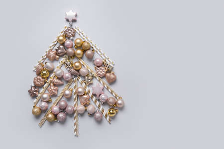 Christmas tree made of silver, golden balls, stars. Xmas greeting card with copy space. Stok Fotoğraf