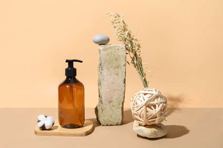 SPA natural accessories, bottle with cosmetic or body care on beige background. Natural skin care. Wellness. Creative composition with podium.