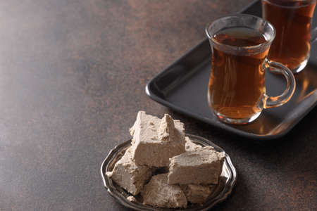 Oriental halva and tea in glass cups . Reklamní fotografie