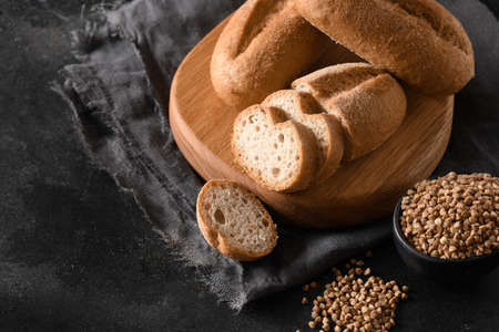 Gluten-free healthy buckwheat bread on black background with copy space.