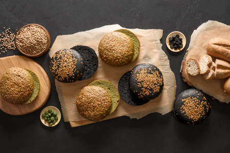 Gluten-free vegan bread and buns various types with buckwheat, spirulina, charcoal on black.