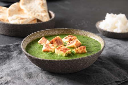 Palak Paneer served basmati rice on grey background. Reklamní fotografie