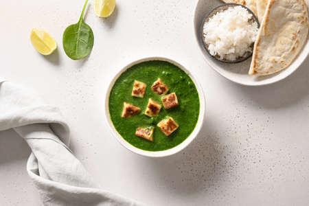 Indian vegetarian cuisine Palak Paneer served on white. Reklamní fotografie