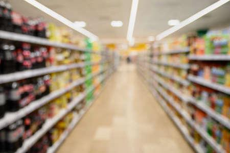 Shelves in supermarket as blurred background for design. Reklamní fotografie