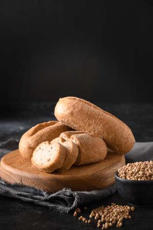 Gluten free buckwheat bread or buns on black.