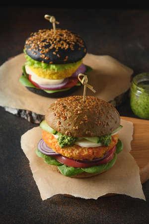 Vegan Burger of spirulina buns, vegetables, carrot meatballs. Reklamní fotografie