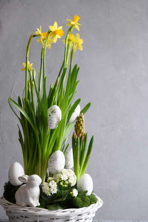 Easter handmade flower composition with blossom narcissus.