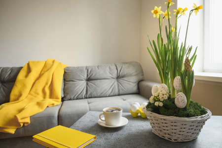 Spring Easter home interior in living room with cup of coffee.