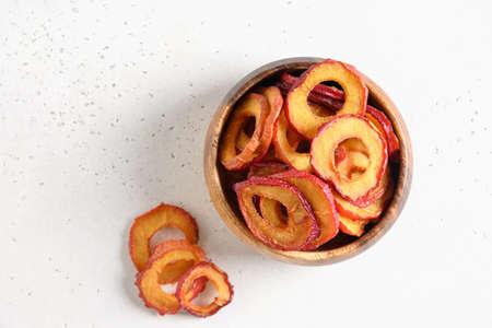 Dried sliced fruits plums in wooden bowl. Reklamní fotografie - 166826811