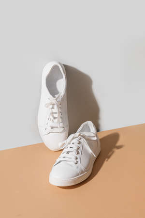 White womens new gumshoes on grey and beige background.