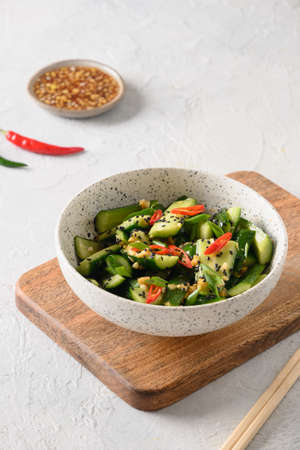 Asian spicy cold appetizer Broken Cucumbers with fresh coriander, ginger, pepper chili, black vinegar.