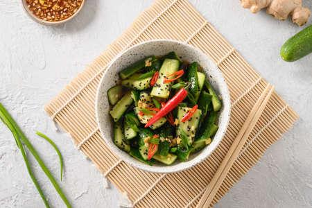 Asian spicy salad Broken Cucumbers with fresh coriander, ginger, pepper chili, black vinegar.
