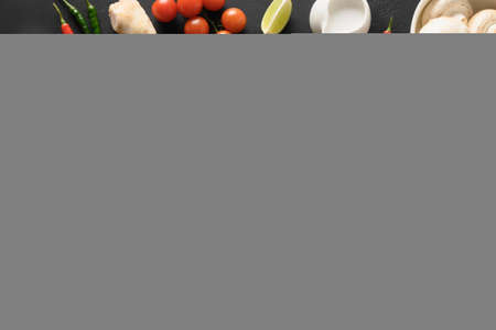 Asian Tom Kha Gai soup. Spicy coconut with chicken, cherry tomato. Standard-Bild