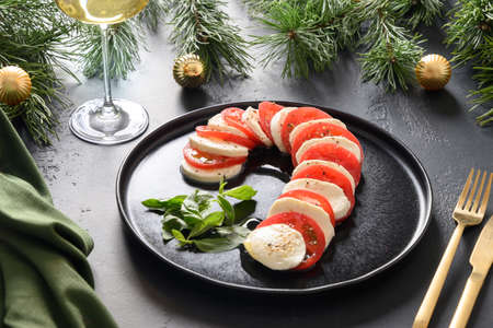 Christmas caprese salad served as Candy Cane for festive party.