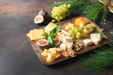 Christmas ceese platter with different cheese and appetizer.