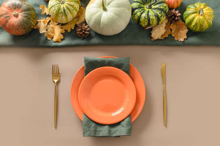 Autumn table setting decorated fall harvest for Thanksgiving day.