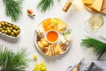 Christmas party with cheese platter, grapes, nuts, olive, figs. Appetizer for party.