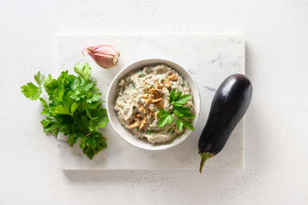 Baba ganoush from baked eggplant with parsley, garlic. View from above.