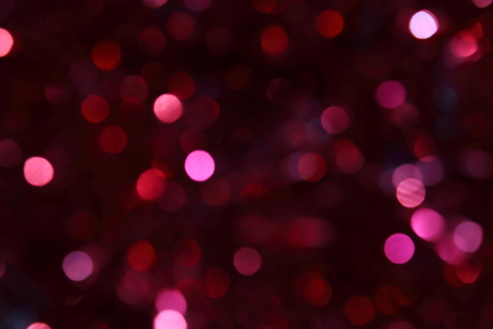 Blurred festive magical background colors of burgundy wine with bokeh effect