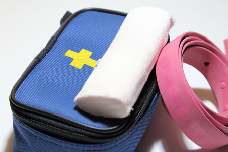 First aid kit for first aid in case of trauma, tourniquet for stopping bleeding, bandage for bandaging. Stock Photo