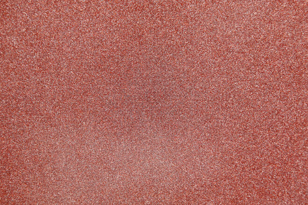 The background is an empty granular claret, brown from abrasive material.