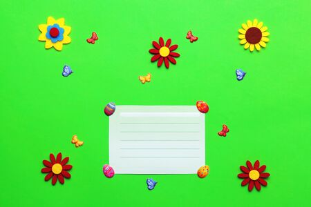 Bright green Easter baby background for cover with flowers, butterflies and eggs.